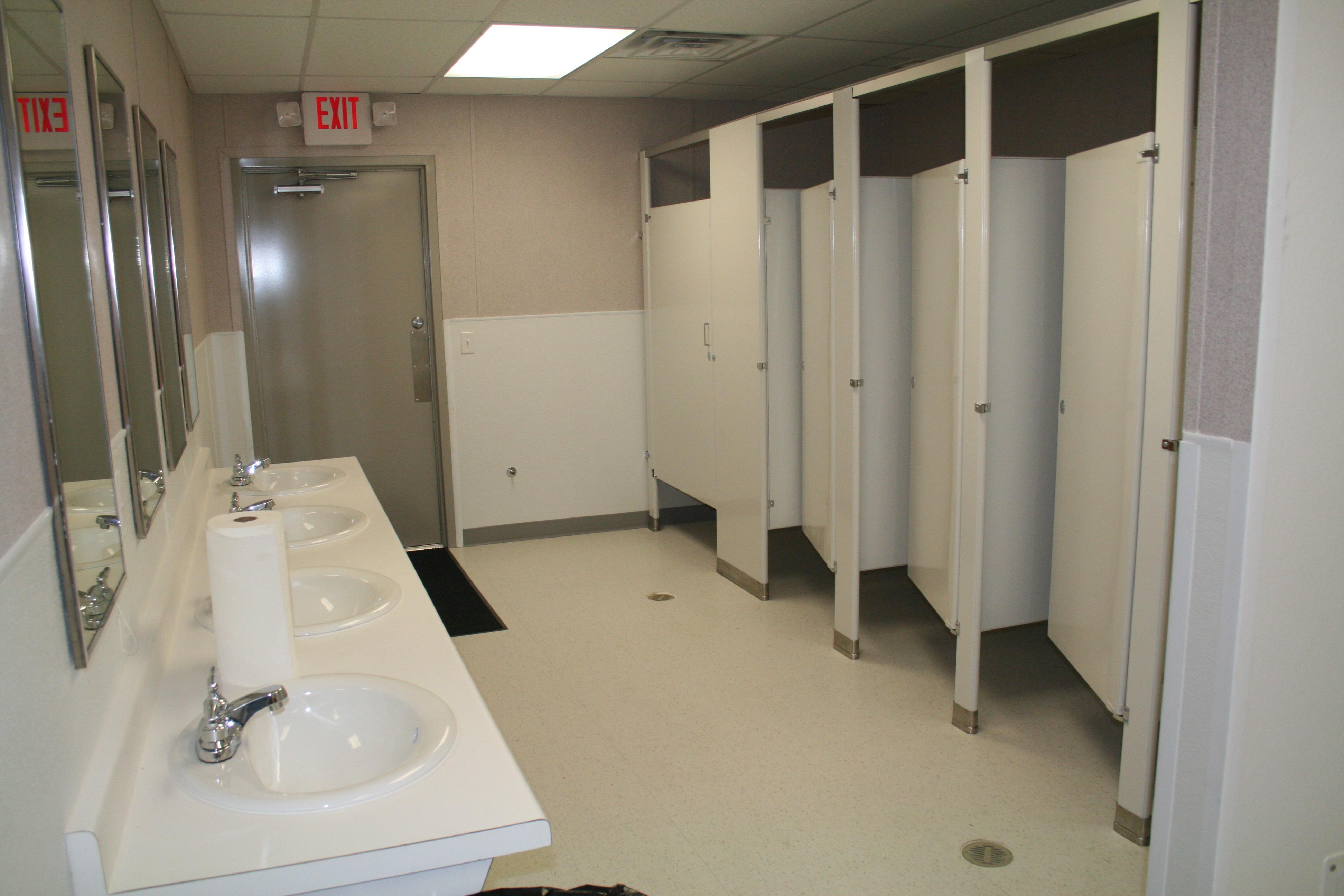 Plenty of toilets and sinks